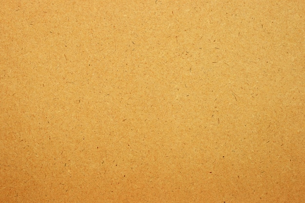 Folha de papel marrom ou fundo de textura de papelão.