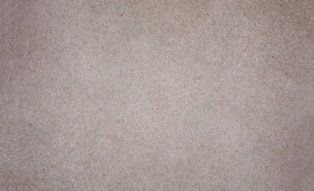 Folha de papel pardo ou textura de papelão para a parede.