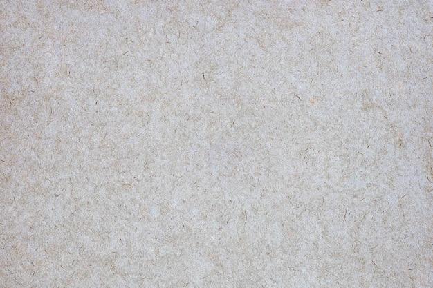 Folha de papel pardo ou textura de papelão para mesa.