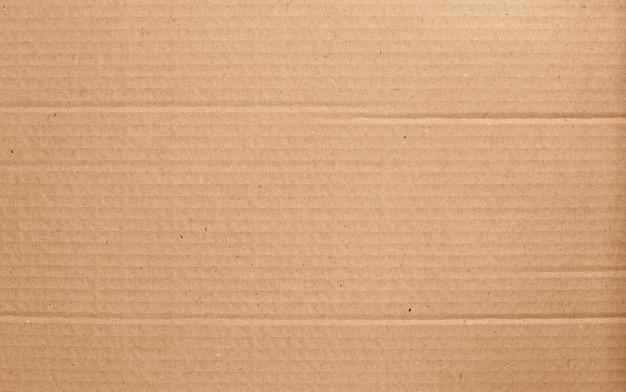 Folha de papelão marrom, textura de caixa de papel reciclado.