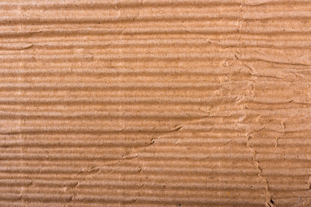 Folha de papelão ondulado marrom com textura de papel ou fundo plano