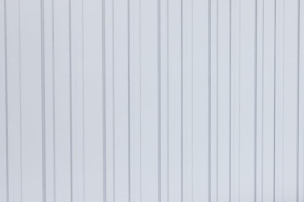 Folha de superfície branca da textura do metal ondulado para o fundo da construção industrial