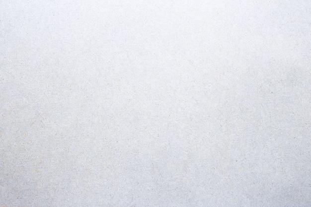 Folha do fundo cinzento branco da textura do papel do grunge.