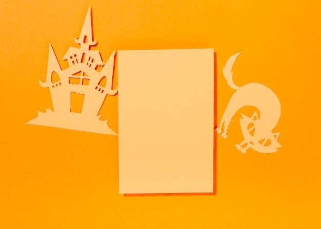 Folha em branco com gato de papel e castelo