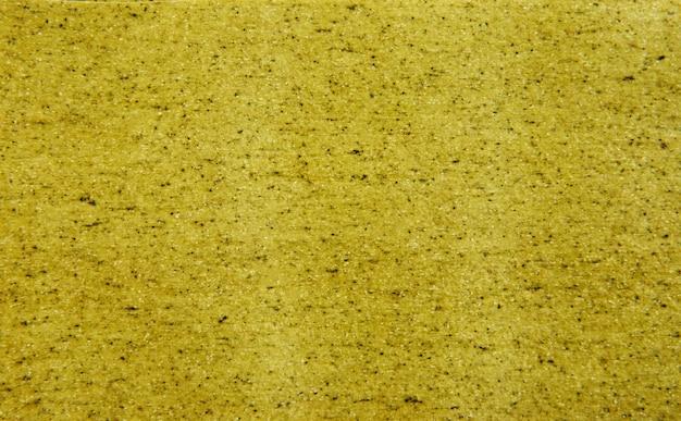 Folha para cozinhar lasanha com textura de fundo de espinafre de tom verde.