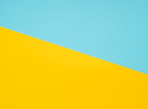 Folhas em branco de papelão amarelo e azul brilhante como textura