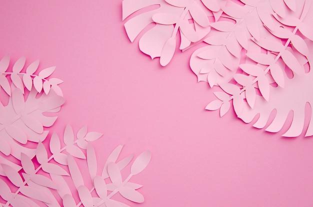 Folhas feitas de papel em tons de rosa