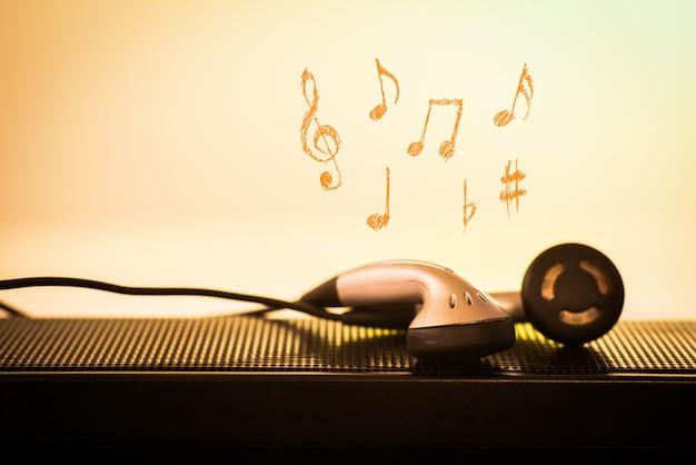 Fone de ouvido com fundo de melodia de desenho