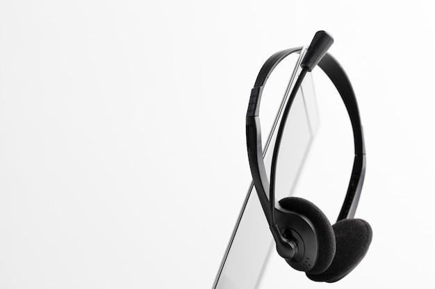 Fone de ouvido e laptop de computador, suporte de call center