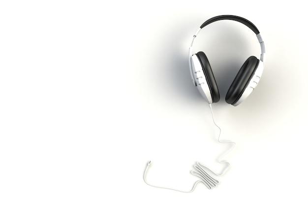 Fones de ouvido brancos sobre fundo branco, vista superior com copyspace para seu texto