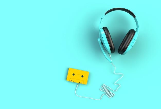Fones de ouvido com fita cassete amarela sobre fundo azul