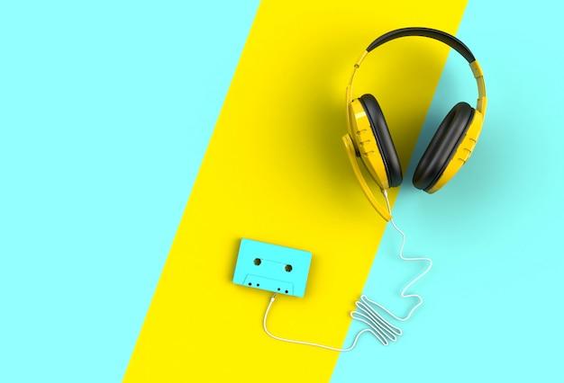 Fones de ouvido com fita cassete azul sobre fundo azul e amarelo