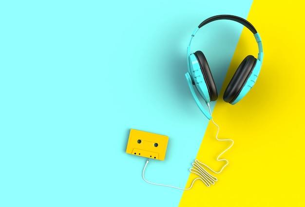 Fones de ouvido com fita cassete no fundo azul e amarelo