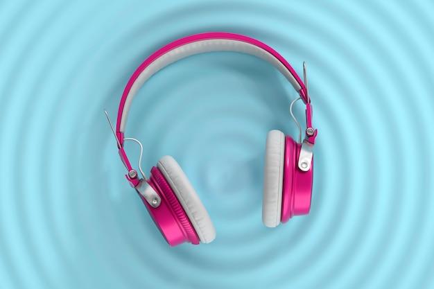 Fones de ouvido com ondas de áudio na superfície azul