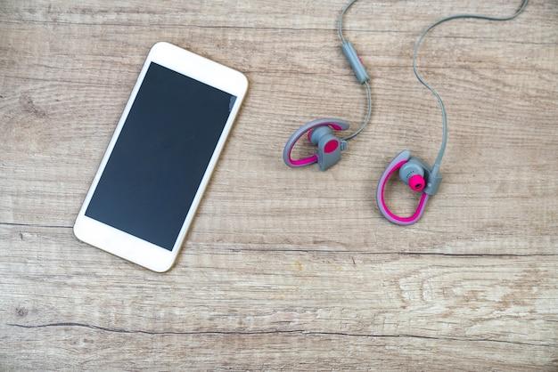 Fones de ouvido e mídia de telefone portátil