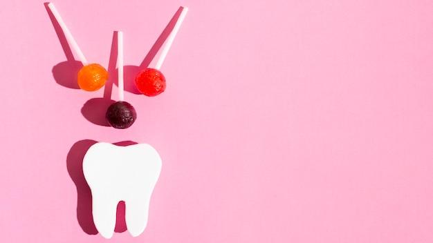 Forma de dente com pirulitos