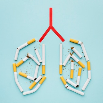 Forma de pulmões com cigarros