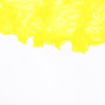 Forma de tinta amarela em aquarela