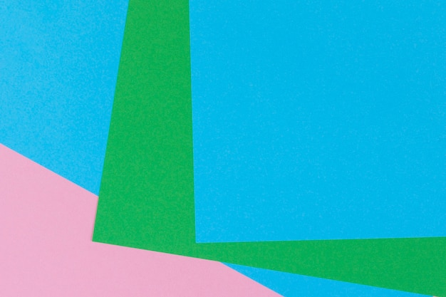 Forma geométrica abstrata, azul claro, verde pastel, cor de fundo de papel rosa