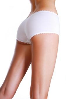 Forma perfeita de nádegas de mulher - estúdio tiro em branco