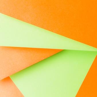 Formas geométricas feitas com um pano de fundo laranja e verde