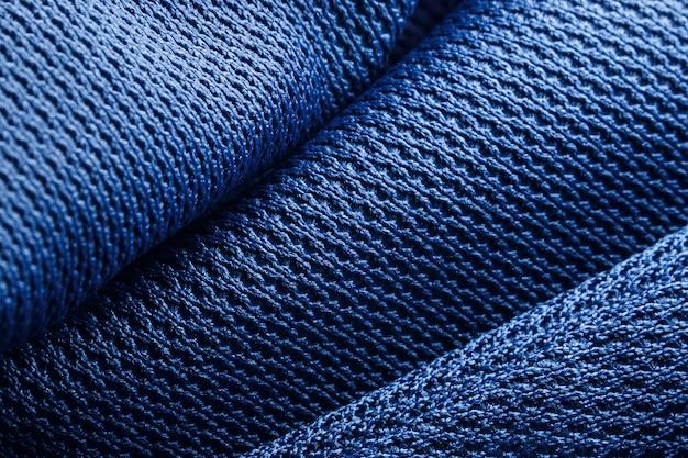 Formas onduladas de textura de tecido de poliéster branco