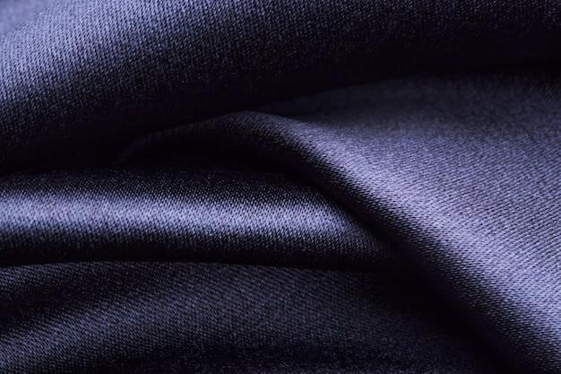 Formas onduladas de textura de tecido de poliéster escuro