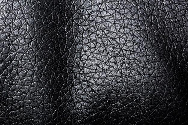 Formas onduladas de textura de tecido preto escuro