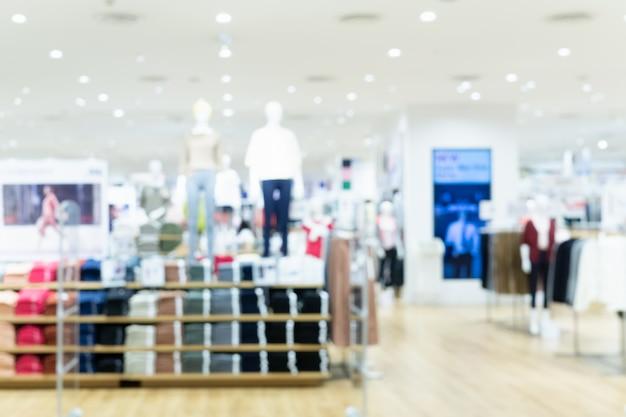 Forme a foto borrada sumário de compra da loja da forma no shopping.