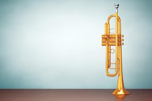 Foto de estilo antigo. trompete de latão polido na mesa