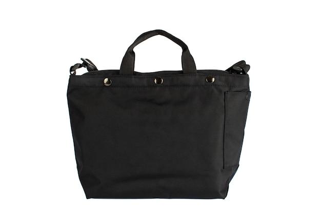Foto de estúdio closeup isolada de nova bagagem casual moderno moderno na moda tecido preto bolsa bolsa com alça no fundo branco.