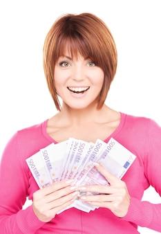 Foto de mulher feliz com dinheiro sobre branco