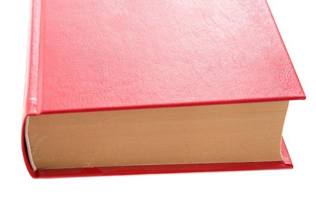 Foto de um livro vermelho sobre um fundo branco