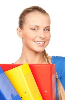 Foto de uma jovem mulher de negócios atraente com pastas
