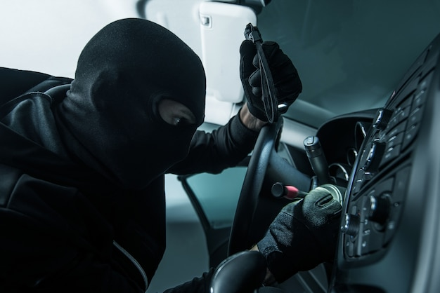 Foto do conceito do ladrão de veículos
