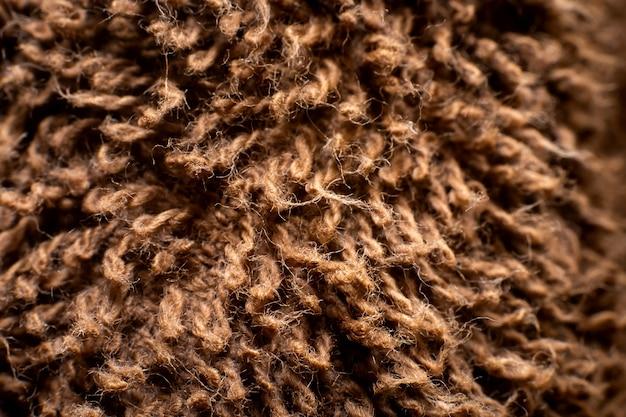 Foto macro de fundo de textura de toalha marrom.