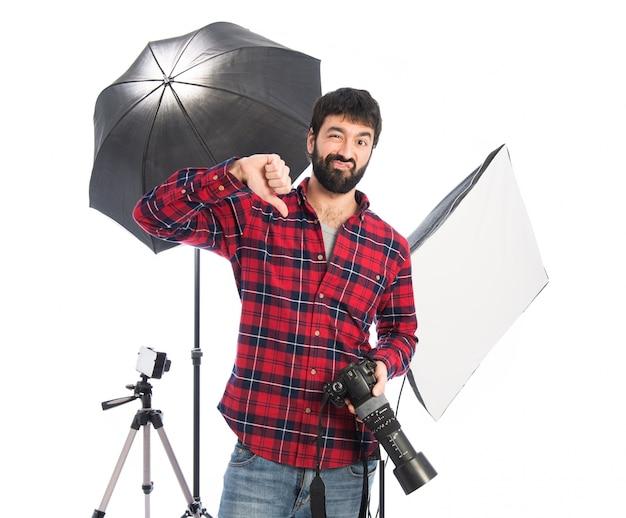 Fotógrafo fazendo sinal ruim