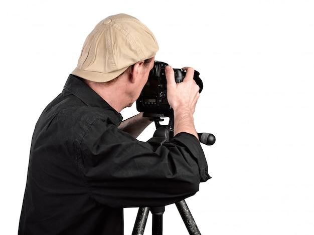 Fotógrafo, olhando através da câmera