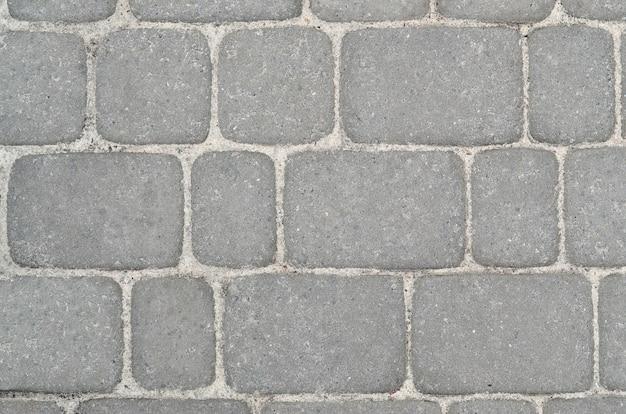 Fragmento da estrada disposta da pedra de pavimentação