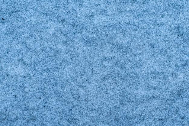 Fragmento da textura azul do tapete como pano de fundo.