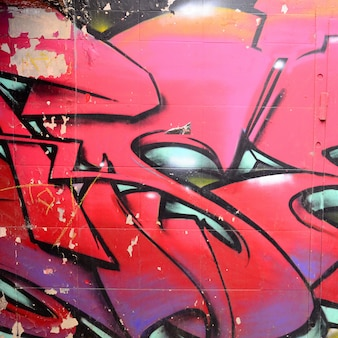 Fragmento de desenhos de graffiti. o velho muro decorado com manchas de tinta no estilo da cultura da arte de rua.