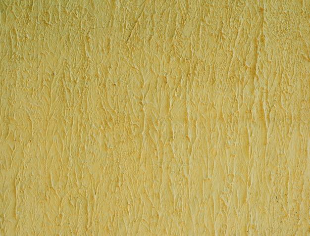 Fragmento de parede de cimento amarelo, estrutura ondulada