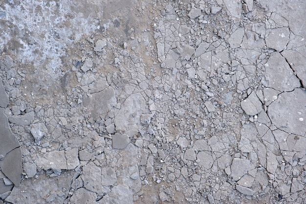 Fragmento do chão de cimento cinza rachado