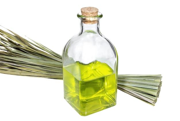 Frasco com óleo aromático e ramo de ervas medicinais