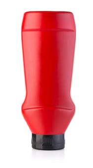 Frasco de ketchup vermelho isolado no branco