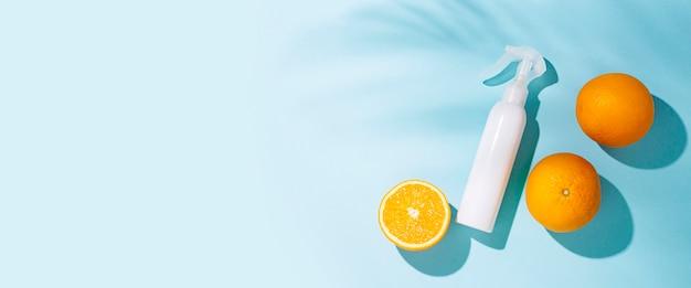 Frasco de spray e laranjas