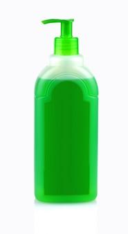 Frasco verde com shampoo com dispensador