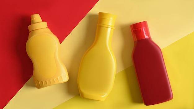 Frascos de molho de plástico em amarelo e fundo de leitura.