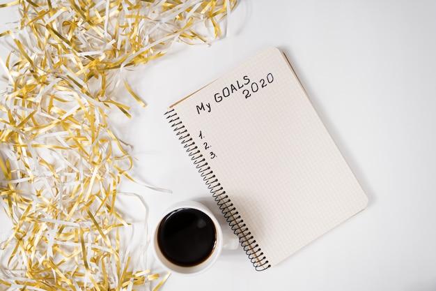 Frase meus objetivos em um caderno.