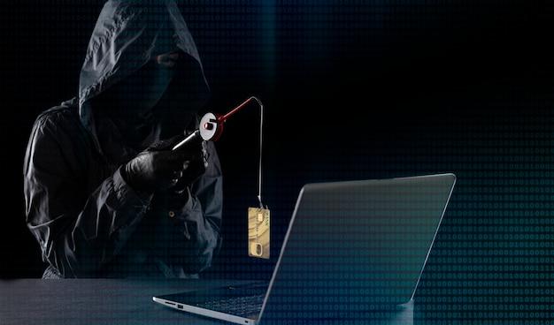 Fraude na internet usando tecnologia de computador, roubo de dinheiro na internet, roubo de dados de cartão de crédito. hacker com uma vara de pescar, hacker pegou um cartão de crédito com uma vara de pescar.